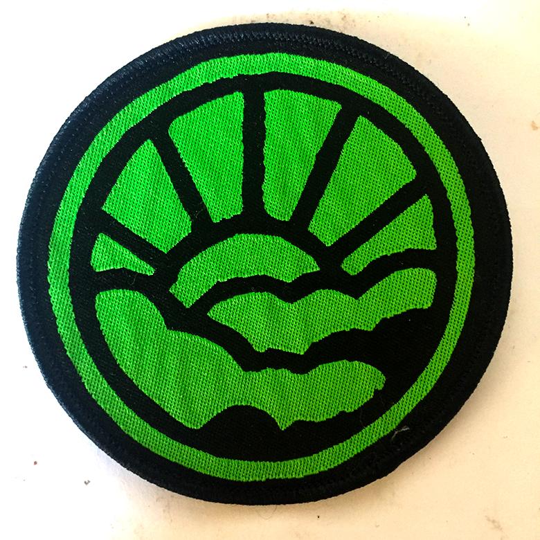 Guerilla Poubelle - patch tissé soleil vert