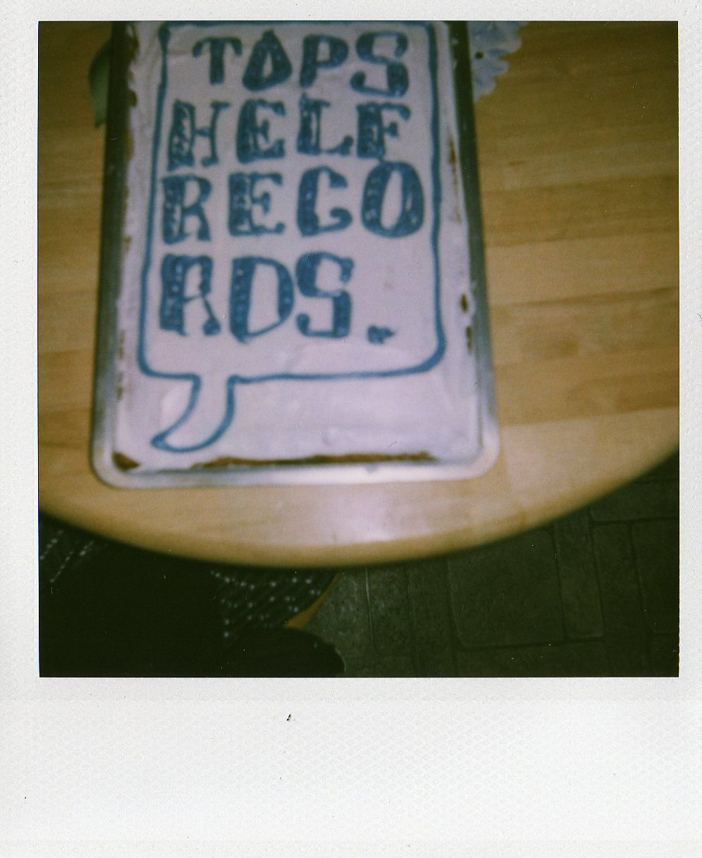A birthday cake with the Topshelf Records logo that our friend Kelly made us for our first birthday.
