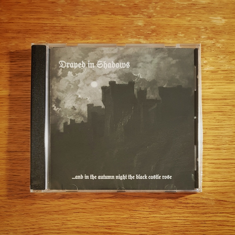 Draped In Shadows - .​.​.​and in the autumn night the black castle rose CD